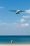 Couple take a selfie photo with landing airplane stock photos