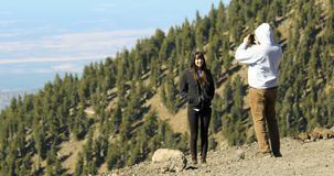 A Couple Takes Cellphone Photos Near Arizona`s Highest Peak. FLAGSTAFF, ARIZONA, OCTOBER 10. Arizona Snowbowl on October 10, 2017, near Flagstaff, Arizona. A Royalty Free Stock Photo