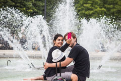 Couple takes selfie in front of Palais Royal fountain, Paris, Fr Royalty Free Stock Photos