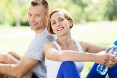 Couple taking a break from exercises Stock Photos