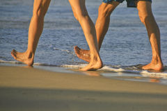 Couple Taking a Brisk Walk on Cabarete Bsy Stock Photos