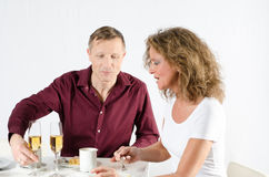 Couple taking coffee break and having a champagne Stock Photography