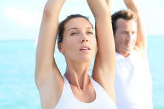 Couple taking a deep breath at yoga excercising Royalty Free Stock Image