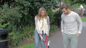 Couple Taking Dog For Walk In City Park stock video footage
