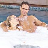 Couple taking foam bubble bath. Happy couple taking foam bubble bath in a hotel whirlpool royalty free stock photography