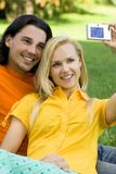 Couple taking photo Stock Image