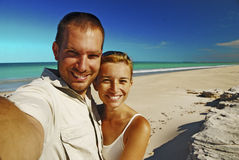 Couple Taking Photo On The Beach Stock Photography