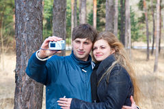 Couple taking photo with camera Stock Photo