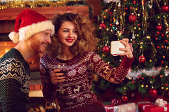 Couple taking photo for Christmas Stock Photography