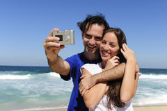 Couple taking a photo with digital camera Royalty Free Stock Photography