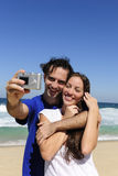 Couple taking a photo with digital camera Stock Images