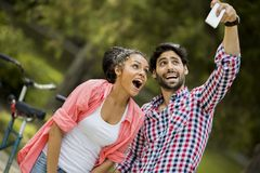 Couple taking photo with mobile phone Stock Photography