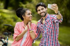 Couple taking photo with mobile phone Stock Image