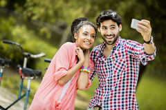 Couple taking photo with mobile phone Stock Images