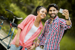 Couple taking photo with mobile phone Royalty Free Stock Photo
