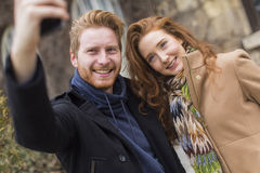 Couple taking photo with mobile phone Royalty Free Stock Photos