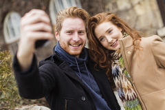 Couple taking photo with mobile phone Royalty Free Stock Images