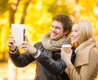 Couple taking photo picture autumn park Royalty Free Stock Photos
