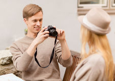 Couple taking photo picture in cafe Royalty Free Stock Photos
