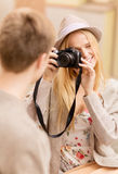 Couple taking photo picture in cafe Royalty Free Stock Images