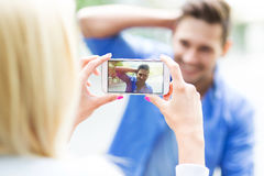 Couple taking photo with smartphone Stock Photography