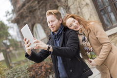 Couple taking photo with tablet Stock Photos
