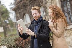 Couple taking photo with tablet Royalty Free Stock Photo
