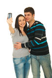 Couple taking photo with their phone Royalty Free Stock Images