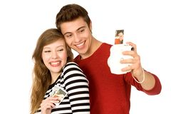 Couple taking photo of themselves Stock Photography