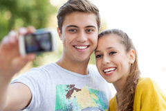 Couple taking photo of themselves Royalty Free Stock Photos