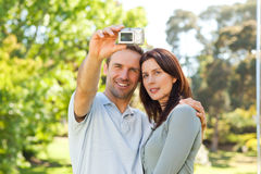 Couple taking a photo of themselves in the park Stock Photo