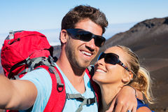 Couple Taking a Photo of Themselves with Phone royalty free stock photos