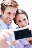 Couple taking photo of themselves Stock Image