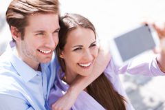 Couple taking photo of themselves Royalty Free Stock Photo