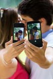 Couple taking photo of themselves with smart phone on romantic p Stock Image