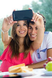 Couple taking photo of themselves with smart phone on romantic p Stock Photo