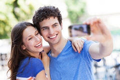 Couple taking photo of themselves Royalty Free Stock Photography
