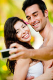 Couple Taking Photograph Royalty Free Stock Photography