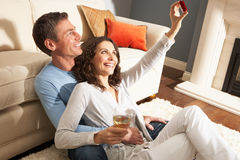 Couple Taking Photograph On Digital Camera At Home Royalty Free Stock Images