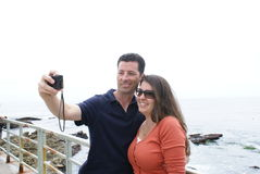 Couple Taking Photograph of Themselves Royalty Free Stock Images