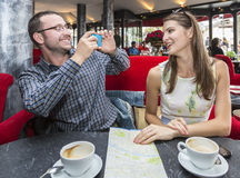 Couple Taking Photos in a Cafe stock images