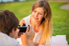Couple taking photos of each other with retro vintage camera on Stock Image