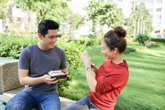 Couple taking photos in food in park royalty free stock photos