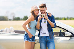 Couple taking photos while out on a road trip Stock Photo