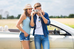 Couple taking photos while out on a road trip Royalty Free Stock Images