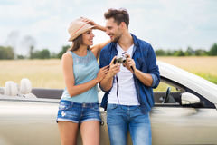 Couple taking photos while out on a road trip Stock Photos