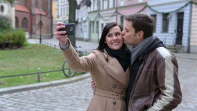 Couple taking photos of themselves Royalty Free Stock Image