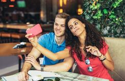 Couple taking photos of themselves with mobile phone Stock Image