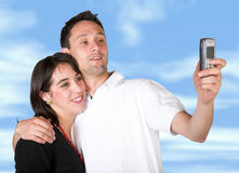 Couple taking a pic with cell phone Royalty Free Stock Photography