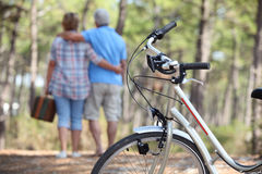 Couple taking a picnic. To the woods by bike Stock Images